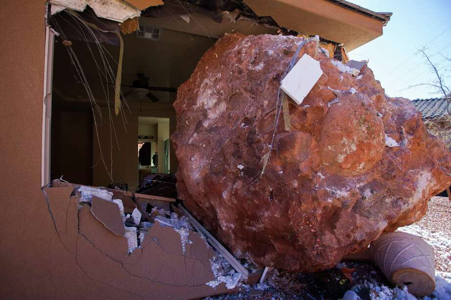 """This boulder smashed into the home of Wanda and Scot Denhalter's in St. George, Utah, on Saturday. Wanda Denhalter, 63, narrowly missed being crushed by the """"big, giant fist"""" that hit her bedroom. Photo: Trevor Christensen, MBR / The Spectrum"""