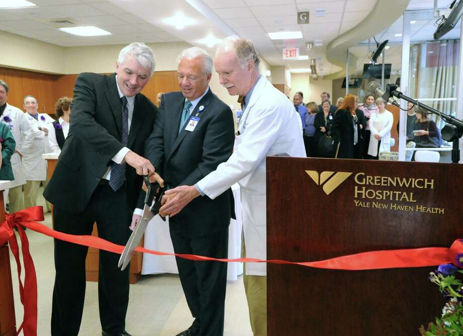 From left, Thomas J. Lynch, Jr., MD, director of Yale Cancer Center and physician-in-chief of the Smilow Cancer Center at Yale New Haven, Frank Corvino, president & CEO of Greenwich Hospital and Dickerman Hollister, Jr., medical director of the Bendheim Cancer Center, cut the ribbon celebrating the recently renovated Bendheim Cancer Center at 77 Lafayette Place, Greenwich, Tuesday afternoon, Jan. 22, 2013. Photo: Bob Luckey / Greenwich Time