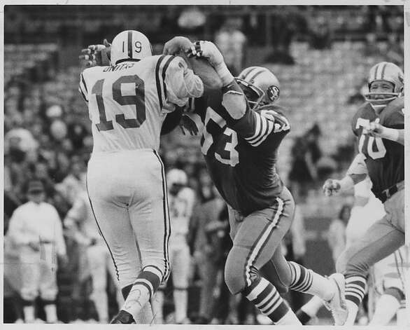 49er Tommy Hart drops john Unitas for a loss in QB's only appearance of the game. Photo was taken 10/3/72. Photo: Jerry Telfer, The Chronicle