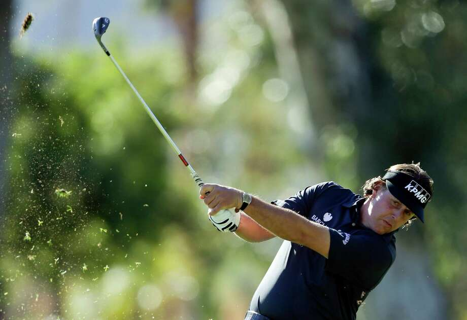 Phil Mickelson hits from a fairway on the fifth hole during the first round of the Humana Challenge golf tournament at the La Quinta Country Club in La Quinta, Calif., Thursday, Jan. 17, 2013. (AP Photo/Chris Carlson) Photo: Chris Carlson