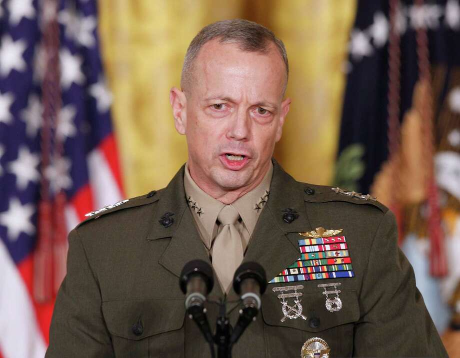 "FILE -- In an April 28, 2011, file photo then-Lt. Gen. John Allen, speaks in the East Room of the White House in Washington. U.S. defense officials say Gen. Allen, the top U.S. commander in Afghanistan, has been cleared of allegations of sending potentially inappropriate emails to a civilian woman linked to the sex scandal that ousted David Petraeus as CIA director. The officials said Tuesday, Jan. 22, 2012, the Defense Department's inspector general found the concerns about the Allen emails to be ""unsubstantiated."" (AP Photo/Charles Dharapak/file) Photo: Charles Dharapak"