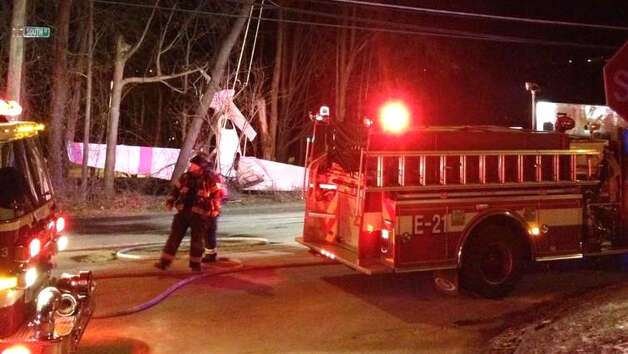 A small plane crashed Tuesday night near South Street in Danbury after deploying a parachute to break its fall, which got caught in power lines. Credit:@joe_britton49 Photo: Contributed Photo / Connecticut Post Contributed