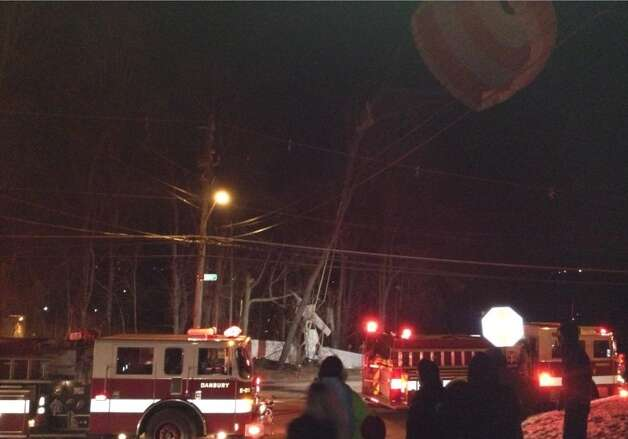 A small plane crashed Tuesday night near South Street in Danbury after deploying a parachute to break its fall, which got caught in power lines. Credit:zbtcapone Photo: Contributed Photo / Connecticut Post Contributed