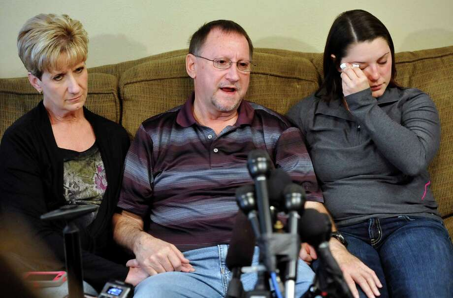 Erin Lovelady, right, with uncle Micheal Lovelady, and his wife, Wanda, of Nederland, said she last saw her father at Christmas when he was home from Algeria. Photo: Dave Ryan