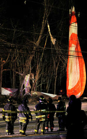 Local fire and rescue units were called to an airplane that crashed near the corner of South Street and Wixted Avenue in Danbury on Tuesday, Jan. 22, 2013. Photo: Jason Rearick / The News-Times