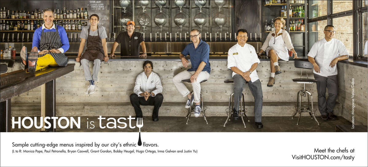 Houston chefs, from left, Monica Pope, Paul Petronella, Bryan Caswell, Grant Gordon, Bobby Heugel, Hugo Ortega, Irma Galvan and Justin Yu pose at Mongoose Versus Cobra restaurant/bar for a photo that will be used in the Greater Houston Convention and Visitors Bureau ad campaign that begins Feb. 14, 2013.