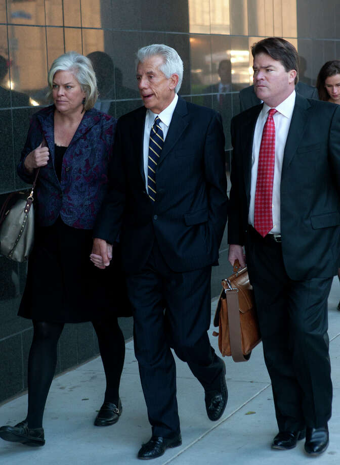 "James Davis, center, enters court Tuesday for sentencing with his wife, Laurie, and attorney David Finn. He was sentenced to five years in prison, followed by three years of probation. Davis told a judge, ""I perverted what is right and I did wrong."" Photo: Cody Duty, Staff / © 2012 Houston Chronicle"