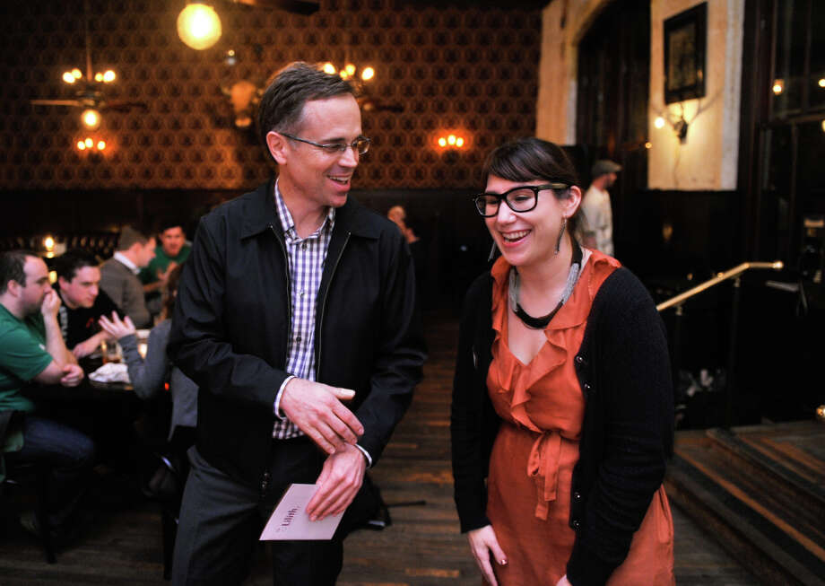 Jeffrey Hons, President of the Planned Parenthood Trust of South Texas talks with Lindsay Rodriguez of the Lilith Fund enjoy a laugh during a reception to celebrate the 40th Anniversary of Roe V. Wade Tuesday evening at the Esquire Tavern. Photo: Robin Jerstad