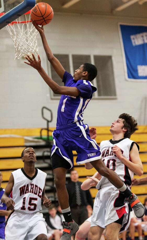 #1 Westhill high school Jeremiah Livingston goes up for a shot in a boys basketball game against  Fairfield Warde high school played at Fairfield Ludlowe high school, Fairfield CT on Tuesday January 22nd, 2013. Photo: Mark Conrad / Connecticut Post Freelance