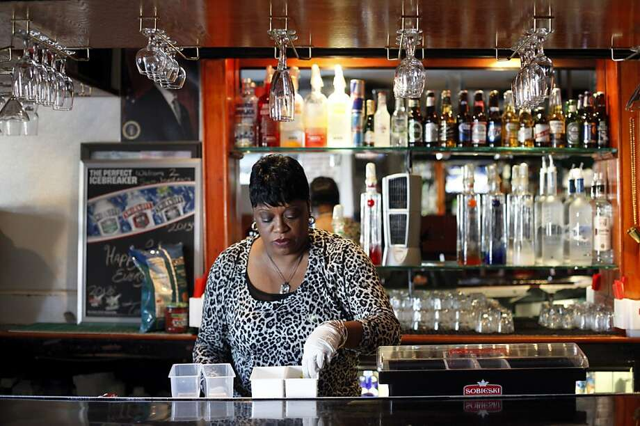 Bartender Denise Tucker gets ready to open at Sam Jordan's Bar in the Bayview. Photo: Sarah Rice, Special To The Chronicle