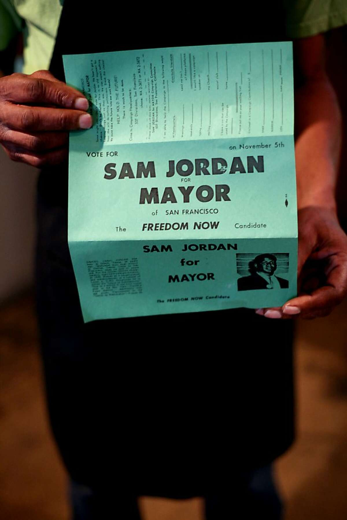 Allen Jordan holds a flyer from when his dad ran for mayor at Sam Jordan's in San Francisco, Calif., Monday, January 21, 2013. The bar recently obtained landmark status.
