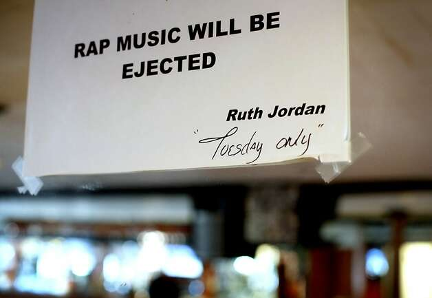 A sign on the wall barring rap music from customer appreciation Tuesdays at Sam Jordan's Bar is shown in San Francisco, Calif., Monday, January 21, 2013.  Ruth Jordan, daughter of Sam Jordan, now runs her father's bar, which recently obtained landmark status.  The Jordans say Tuesdays draw an older crowd, so they cater the music to their tastes. Photo: Sarah Rice, Special To The Chronicle