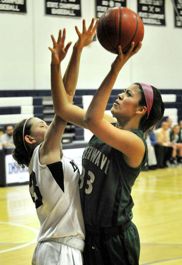New Milford's Emily Llerena shoots over Immaculate's Danielle Cerrone during their game at Immaculate High School in Danbury on Tuesday, Jan. 22, 2013. Photo: Jason Rearick / The News-Times