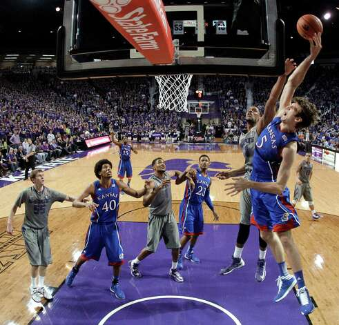 Kansas center Jeff Withey (5) gets past Kansas State guard Shane Southwell to put up a shot during the first half of an NCAA college basketball game Tuesday, Jan. 22, 2013, in Manhattan, Kan. (AP Photo/Charlie Riedel) Photo: Charlie Riedel, Associated Press / AP