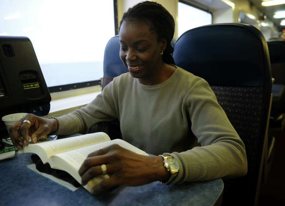 Andreia Blanchard, of Shelton, reads a book during her daily commute to work on the Bridgeport/Port Jefferson ferry on Tuesday, January 15, 2013. Blanchard is a network engineer at Stony Brook University on Long Island. Photo: Brian A. Pounds