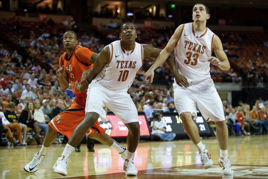 AUSTIN, TX - NOVEMBER 27:  Jonathan Holmes #10 and Ioannis Papapetrou #33 of the University of Texas Longhorns attempt to box out Terrance Motley #24 of the Sam Houston State Bearkats on November 27, 2012 at the Frank Erwin Center in Austin, Texas.  (Photo by Cooper Neill/Getty Images) Photo: Cooper Neill, Stringer / 2012 Getty Images