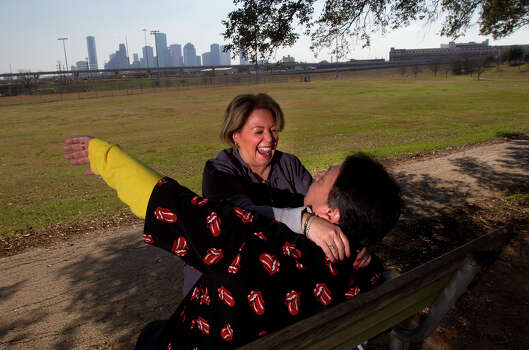 "Wade Pierre gestures as he makes his girlfriend, Sally Perez laugh during her lunch break at Stude Park Tuesday, Jan. 22, 2013, in Houston. Perez said they came to the park because of the weather. ""It's so beautiful,"" she said. Photo: Cody Duty, Houston Chronicle / © 2012 Houston Chronicle"