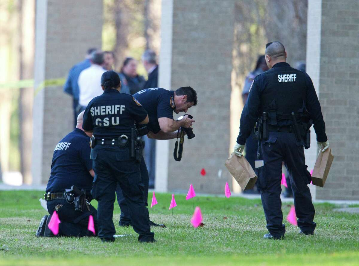 Members of the Sheriff's Crime Scene Unit gather evidence and take photos at Lone Star College on W.W. Thorne Blve, Tuesday, Jan. 22, 2013, in Houston, where a gunman fired multiple rounds on campus.