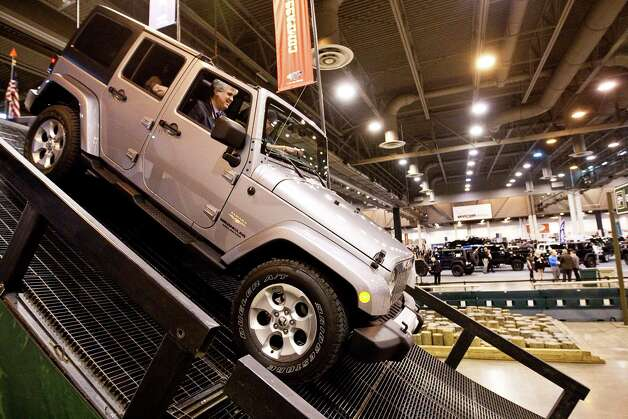 Al Greenfield, of Houston, takes a 30 degree decline ride in a jeep Rubicon on Jeep's 18-foot tall mobile mountain during the Houston Autoshow 30th Preview presented by the Houston Chronicle, Tuesday, Jan. 22, in Reliant Center in Houston. The Auto show begins today and finishes on January 27th. The show offers rides and drives allowing drivers a chance to evaluate new vehicles and a kids fun zone amongst other things. Photo: Nick De La Torre, Houston Chronicle / © 2013  Houston Chronicle