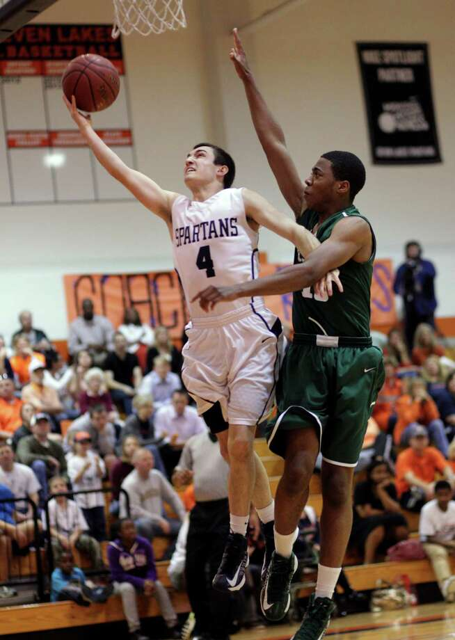 Seven Lake's Robby Byrne #4 drives past Strake's Justin Chekwujekwu (10) for a layup during a District 19-5A basketball game between Strake Jesuit and Seven Lakes, Tuesday, Jan.22, 2013. Photo: Bob Levey, Houston Chronicle / ©2013 Bob Levey