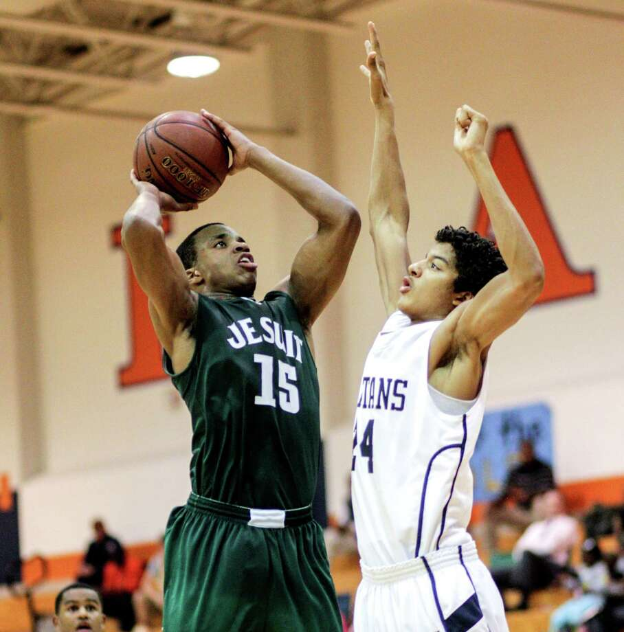 Strake Jesuit's Reveal Chekwujekwu (15) drives over  Seven Lake's Boaz Williams (24)during a District 19-5A basketball game between Strake Jesuit and Seven Lakes, Tuesday, Jan.22, 2013. Strake Jesuit defeated Seven Lakes 55-45. Photo: Bob Levey, Houston Chronicle / ©2013 Bob Levey