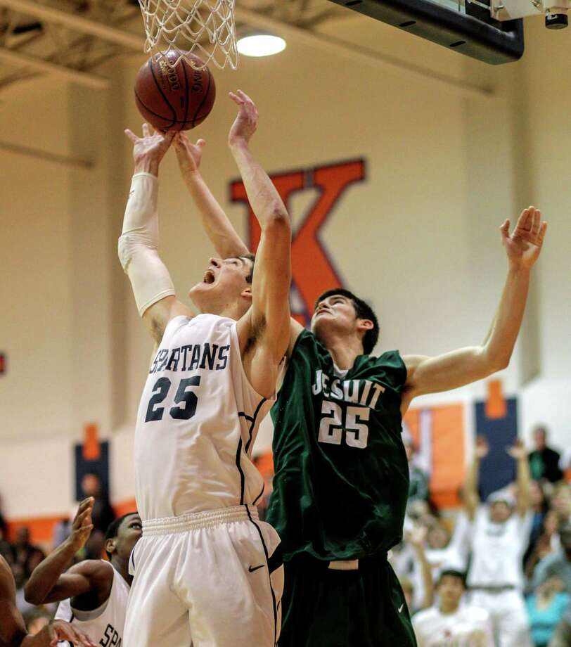 Seven Lake's Ryan McClurg (25) is fouled by Strake Jesuit's Dylan Livit (25) as he grabs a rebound during a District 19-5A basketball game between Strake Jesuit and Seven Lakes, Tuesday, Jan.22, 2013. Strake Jesuit defeated Seven Lakes 55-45. Photo: Bob Levey, Houston Chronicle / ©2013 Bob Levey