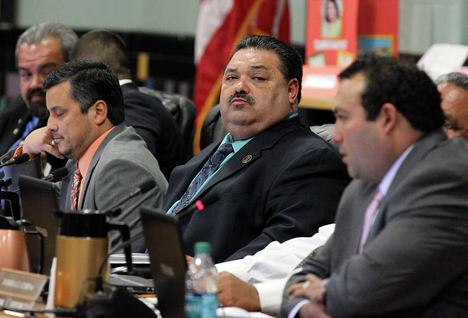 Harlandale ISD Interim Superintendent Rey Madrigal (center) was decided by the board of trustees to be the sole finalist for the permanent position of superintendent during a school board meeting at McCollum High School on Tuesday, Jan. 22, 2013.