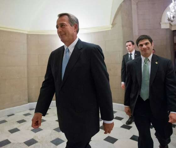 FILE - This Jan. 15, 2013 file photo shows House Speaker John Boehner of Ohio walking on Capitol Hill in Washington. Republican leaders scramble for votes on a stopgap debt-limit measure that would let the government keep borrowing until at least mid-May, giving up for now on trying to win spending cuts from Democrats in return. But the respite would be only temporary, with major battles still to come between the GOP and President Barack Obama over taxes, spending and deficits. (AP Photo/J. Scott Applewhite, File) Photo: J. Scott Applewhite