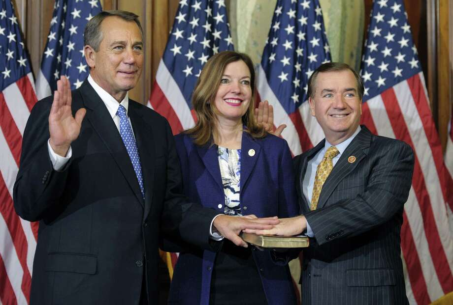 FILE - In this Jan. 3, 2013, file photo, House Speaker John Boehner of Ohio, left, performs a mock swearing in for Rep. Edward Royce, R-Calif., on Capitol Hill in Washington as the 113th Congress began. A harrowing nighttime flight over the African jungle and a wild search for a rebel leader helped forge a relationship between Democratic Sen. Bob Menendez and Royce, two men standing at the forefront of Congress' changing guard on foreign policy. It was May 1997 and the lawmakers boarded a small plane to the African bush to plead with Jonas Savimbi, leader of UNITA, about ordering his forces to put down their arms and end the Angolan civil war. Nearly 16 years later, the two are together again, collaborating as the new chairmen of the respective Senate Foreign Relations and House Foreign Affairs committees. (AP Photo/Cliff Owen) Photo: Cliff Owen