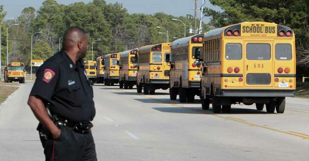 School buses are allowed back on the Nimitz High School campus, which was on lockdown after a shooting at Lone Star College on Tuesday. Photo: James Nielsen, Staff / © Houston Chronicle 2013