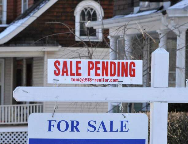 For sale sign outside a home on Campbell Avenue in Schenectady Tuesday Jan. 22, 2013. (John Carl D'Annibale / Times Union) Photo: John Carl D'Annibale / 00020842A