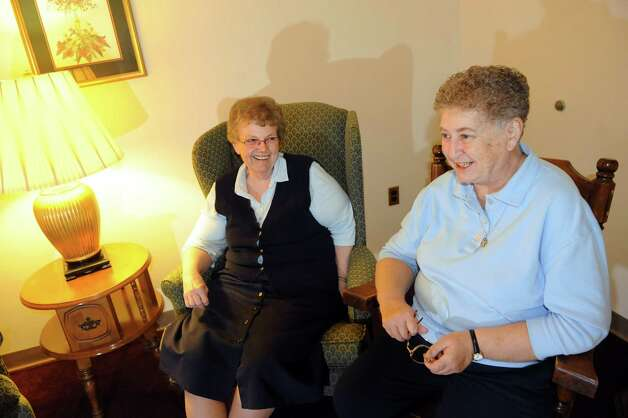 Sister Joanne Donovan, left, and Sister Irene Brassard remember two sister nuns, who recently died, on Tuesday, Jan. 22, 2013, at Louise House in Menands, N.Y. The sister nuns, Elaine and Jean Marie Wheeler, died within 24 hours of each other. (Cindy Schultz / Times Union) Photo: Cindy Schultz / 00020867A
