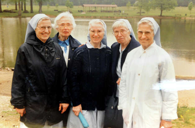 Copied photo from 1992 of the five Wheeler sister nuns on Tuesday, Jan. 22, 2013, at Louise House in Menands, N.Y. From left are sisters Elaine, Mary Cecelia, Zoe, Jean Marie and Madeline. Elaine and Jean Marie just recently died within 24 hours of each other. (Cindy Schultz / Times Union) Photo: Cindy Schultz / 00020867A