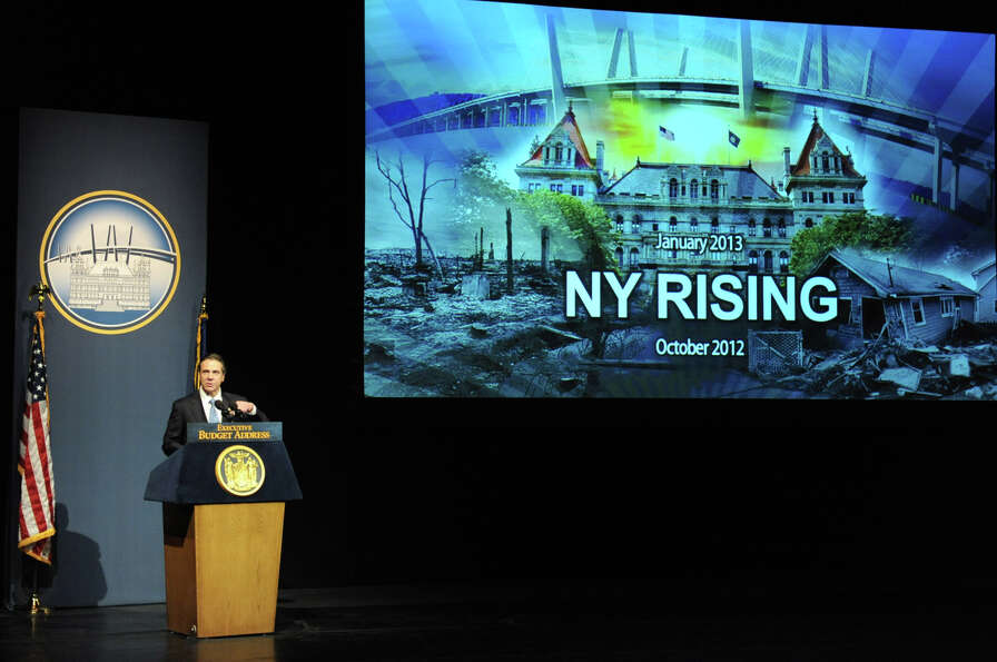 Governor Andrew Cuomo show his last slide on the big screen as he delivers his budget proposal for f