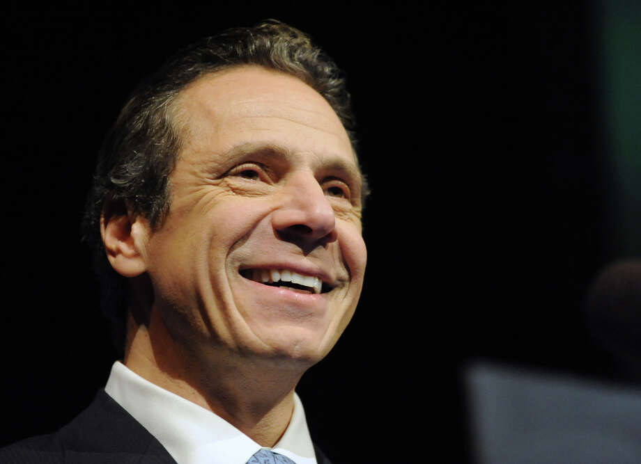 Governor Andrew Cuomo smiles at the audience before delivering his budget proposal for fiscal year 2013-14 in the Hart Theater in The Egg on Tuesday Jan. 22, 2013 in Albany, N.Y.  (Lori Van Buren / Times Union) Photo: Lori Van Buren