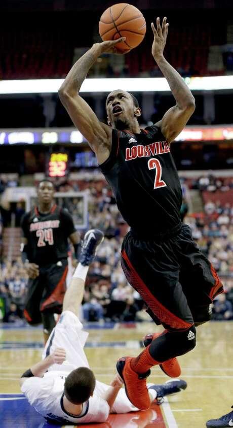 Louisville guard Russ Smith continues to the basket after running over Villanova's Ryan Arcidiacono. Photo: Matt Slocum, STF / AP