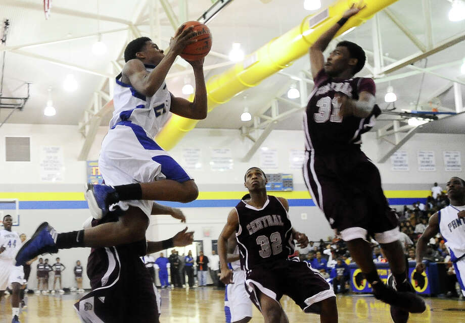 Ozen Panther Chrisitian Bolton, #24, puts it up for two during the Ozen High School boys basketball game against Central High School on Tuesday, January 22, 2013, at Ozen High School. Photo taken: Randy Edwards/The Enterprise Photo: Randy Edwards
