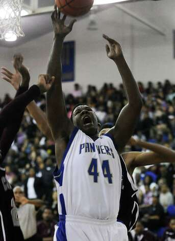 Ozen Panther Caleb Wright, #44, puts it up for two during the Ozen High School boys basketball game against Central High School on Tuesday, January 22, 2013, at Ozen High School. Photo taken: Randy Edwards/The Enterprise Photo: Randy Edwards