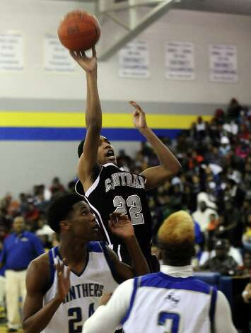 Central Jaguar Nijal Pearson, #22, puts it up for two during the Ozen High School boys basketball game against Central High School on Tuesday, January 22, 2013, at Ozen High School. Photo taken: Randy Edwards/The Enterprise Photo: Randy Edwards