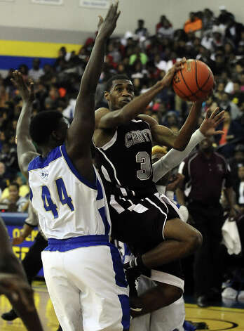Central Jaguar Andre' Morris, #32, puts it up for two during the Ozen High School boys basketball game against Central High School on Tuesday, January 22, 2013, at Ozen High School. Photo taken: Randy Edwards/The Enterprise