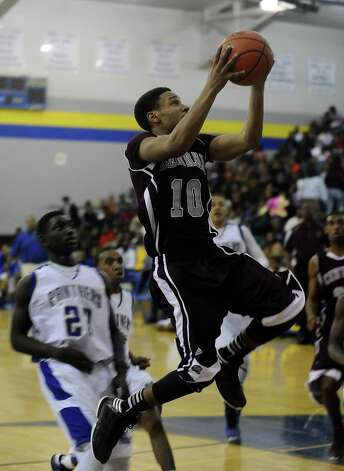 Central Jaguar Garrison Mitchell, #10 puts it up for two during the Ozen High School boys basketball game against Central High School on Tuesday, January 22, 2013, at Ozen High School. Photo taken: Randy Edwards/The Enterprise