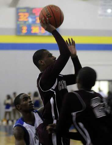 Central Jaguar, Jacory Guillory, #5, puts it up for two during the Ozen High School boys basketball game against Central High School on Tuesday, January 22, 2013, at Ozen High School. Photo taken: Randy Edwards/The Enterprise Photo: Randy Edwards