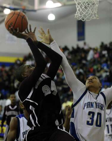 Central Jaguar E'Torrion Wilridge, #24, puts it up for two during the Ozen High School boys basketball game against Central High School on Tuesday, January 22, 2013, at Ozen High School. Photo taken: Randy Edwards/The Enterprise Photo: Randy Edwards