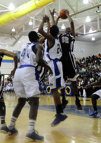 Central Jaguar Andre' Morris, #32, rebounds the ball during the Ozen High School boys basketball game against Central High School on Tuesday, January 22, 2013, at Ozen High School. Photo taken: Randy Edwards/The Enterprise Photo: Randy Edwards