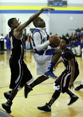Ozen Panther Jakobi Jones, #3, puts it up for two during the Ozen High School boys basketball game against Central High School on Tuesday, January 22, 2013, at Ozen High School. Photo taken: Randy Edwards/The Enterprise Photo: Randy Edwards