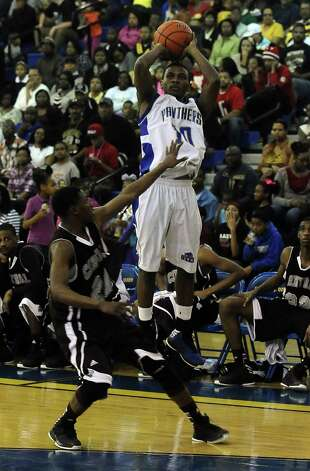 Ozen Panther Ryan Haynes puts it up for three during the Ozen High School boys basketball game against Central High School on Tuesday, January 22, 2013, at Ozen High School. Photo taken: Randy Edwards/The Enterprise Photo: Randy Edwards