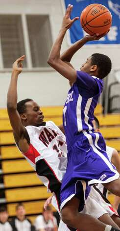 #15 Fairfield Warde high school Terrance Walden can't stop #1 Westhill high school Jeremiah Livingston from getting a basket in a boys basketball game played at Fairfield Ludlowe high school, Fairfield CT on Tuesday January 22nd, 2013. Photo: Mark Conrad / Connecticut Post Freelance