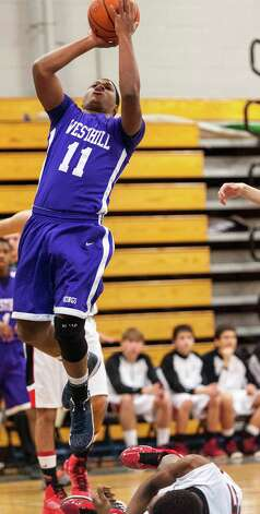 #11 Westhill high school Guyveson Cassamajor goes up for a shot in a boys basketball game against Fairfield Warde high school played at Fairfield Ludlowe high school, Fairfield CT on Tuesday January 22nd, 2013. Photo: Mark Conrad / Connecticut Post Freelance