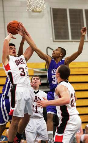#32 Fairfield Warde high school Daniel Cetta pulls down a rebound in a boys basketball game against Westhill high school played at Fairfield Ludlowe high school, Fairfield CT on Tuesday January 22nd, 2013. Photo: Mark Conrad / Connecticut Post Freelance