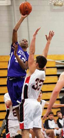 #42 Westhill high school Nygel Belizare goes up for a shot in a boys basketball game against Fairfield Warde high school played at Fairfield Ludlowe high school, Fairfield CT on Tuesday January 22nd, 2013. Photo: Mark Conrad / Connecticut Post Freelance